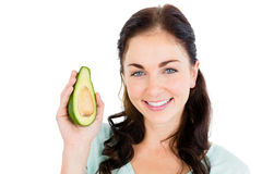 Portrait of happy woman holding avocado Royalty Free Stock Photo