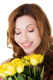 Portrait happy woman holding bunch of roses Royalty Free Stock Photography
