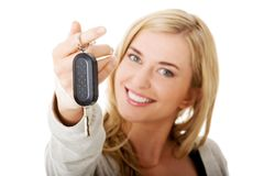 Portrait of happy woman holding a car key Stock Images