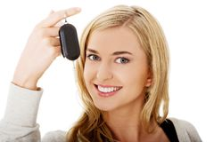 Portrait of happy woman holding a car key Royalty Free Stock Photo