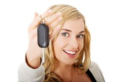 Portrait of happy woman holding a car key Royalty Free Stock Photos