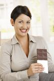 Portrait of happy woman holding chocolate Stock Photography