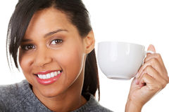 Portrait happy woman holding a cup of coffee Stock Photos