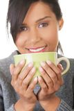 Portrait happy woman holding a cup of tea Stock Photos