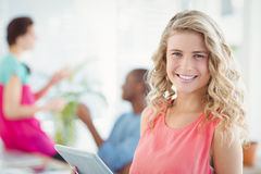 Portrait of happy woman while holding digital tablet Stock Photos