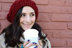 Portrait of young woman holding hot coffee Royalty Free Stock Photos