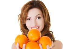 Portrait of a happy woman holding oranges Stock Images