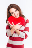 Portrait of a happy woman holding red heart Royalty Free Stock Photo