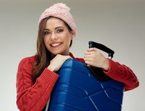 Portrait of happy woman holding travel case. Royalty Free Stock Images