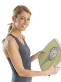 Portrait Of Happy Woman Holding Weight Scale Stock Images