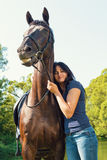 Portrait of happy woman and the horse. Royalty Free Stock Images