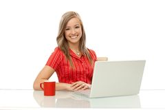 Portrait of happy woman with laptop Royalty Free Stock Photography