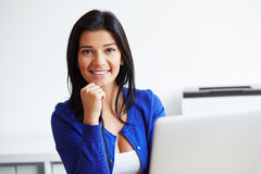 Portrait of happy woman with laptop in the home office Stock Images