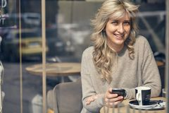 Portrait of a happy woman looking at the phone. And very joyful Royalty Free Stock Images