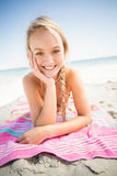 Portrait of happy woman lying on the beach Royalty Free Stock Images