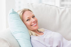 Portrait of happy woman lying on sofa Royalty Free Stock Image