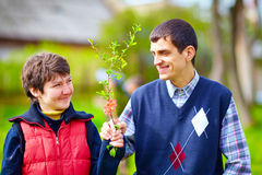 Portrait of happy woman and man with disability together on spring lawn royalty free stock image