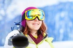 Portrait of happy woman in mask holding ski. Portrait of happy woman in mask standing and holding ski during winter day on Krasnaya polyana ski resort and Stock Image