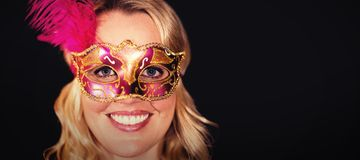 Portrait of happy woman in masquerade mask Stock Image