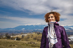 Portrait of a happy woman on the mountains Royalty Free Stock Image