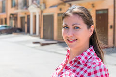 Portrait of happy woman near her new house Stock Image