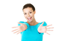 Portrait of a happy woman with open hands gesture Stock Photography