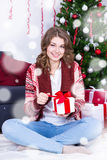 Portrait of happy woman opening christmas gift box in decorated Stock Image