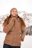 Portrait of happy woman outdoors among snow-capped mountains Stock Photography
