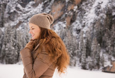 Portrait of happy woman outdoors among snow-capped mountains Royalty Free Stock Photo