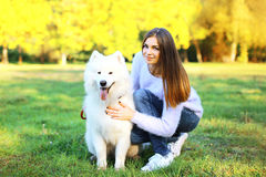 Portrait happy woman owner and dog in the park. Outdoors royalty free stock photos