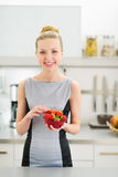 Portrait of happy woman with plate of strawberries Royalty Free Stock Image