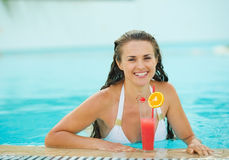 Portrait of happy woman at pool with cocktail Royalty Free Stock Images