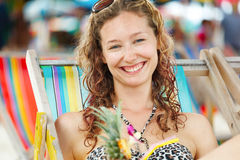 Portrait of a happy woman posing while on the beach Stock Photos