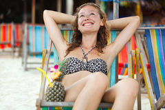 Portrait of a happy woman posing while on the beach Royalty Free Stock Images