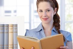Portrait of happy woman reading book Royalty Free Stock Photography