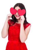 Portrait of happy woman in red dress covering eyes with two pape Royalty Free Stock Images