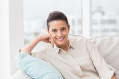 Portrait of happy woman relaxing on sofa Royalty Free Stock Photos