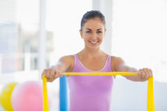Portrait of happy woman with resistance band Stock Photo