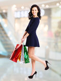 Portrait of happy woman with shopping bags. Royalty Free Stock Image