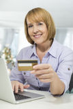 Portrait of happy woman shopping online at home during Christmas Royalty Free Stock Photo