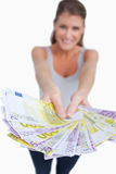 Portrait of a happy woman showing bank notes Royalty Free Stock Images