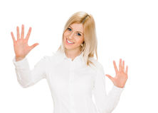 Portrait of happy woman showing ten fingers Royalty Free Stock Photos