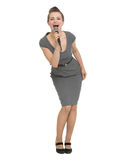 Portrait of happy woman singing in microphone royalty free stock images