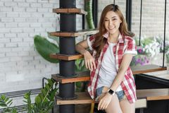Happy woman sitting on wooden stair royalty free stock photo