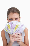 Portrait of a happy woman smelling bank notes Stock Photo