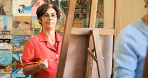 Portrait Of Happy Woman Smiling Painting At Art School Royalty Free Stock Photo