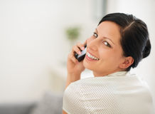 Portrait of happy woman speaking cellphone Royalty Free Stock Image