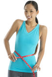 Portrait Of Happy Woman In Sports Clothing Measuring Her Waistli Stock Photo