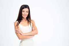 Portrait of a happy woman standing with arms folded Royalty Free Stock Photos