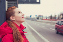 Portrait of happy woman standing outside at a bus stop, cute smiling. Happy woman standing outside at a bus stop, cute smiling royalty free stock photos